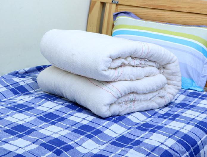 新疆长绒棉被子春 棉被批发手工棉花被 学生手工棉被芯图片